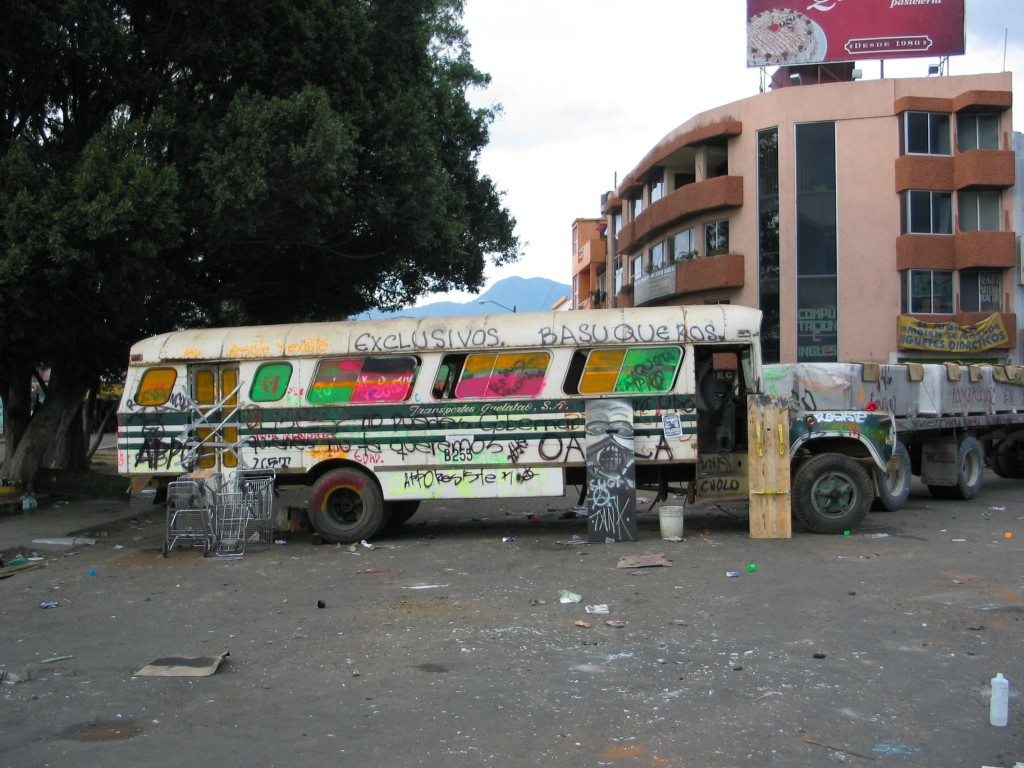 A bus serving as a road block for the protesters.