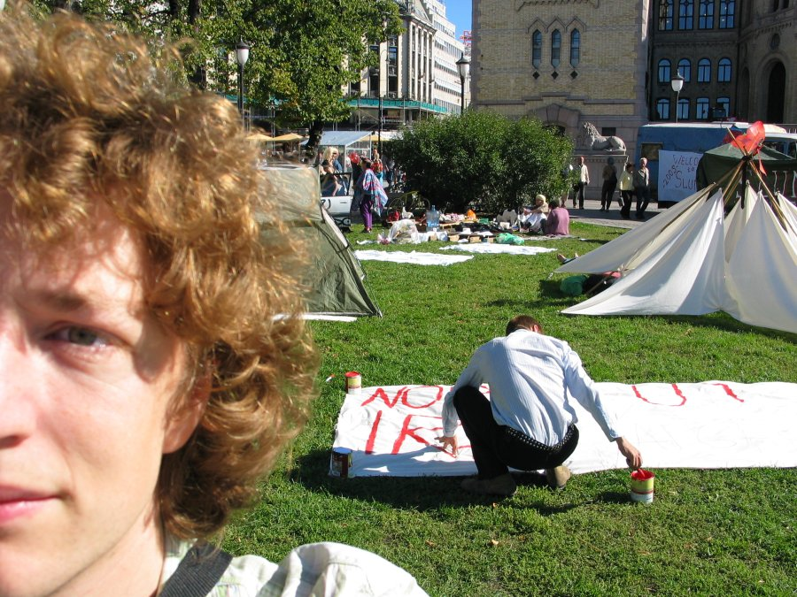Camping for a cause - in the background the Norwegian parliament