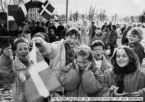 "In German: ""The children greeted the Danish queen with the Danish flag."" (Grätsch, Wochenschau, 1 April, 1992) I am on the far left and it says ""Denmark"" on my forehead"