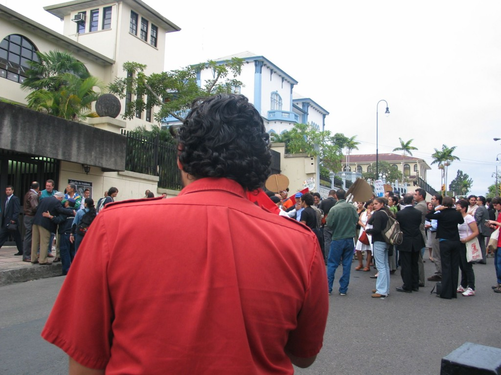 Cesar Lopez holds a speech at a mini demonstration of about 100 activists who were called togetehr the night before to protest that the national assembly is trying to fast track the vote on CAFTA.