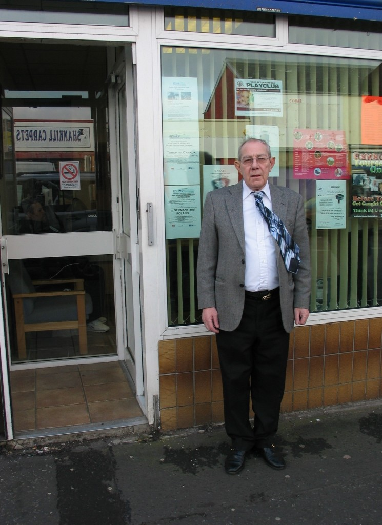 Hugh Smyth is standing outside his office in the Shankills Road.